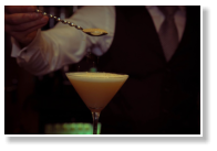 Bar man serves a cocktail